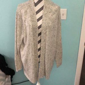 White cardigan with black dots.